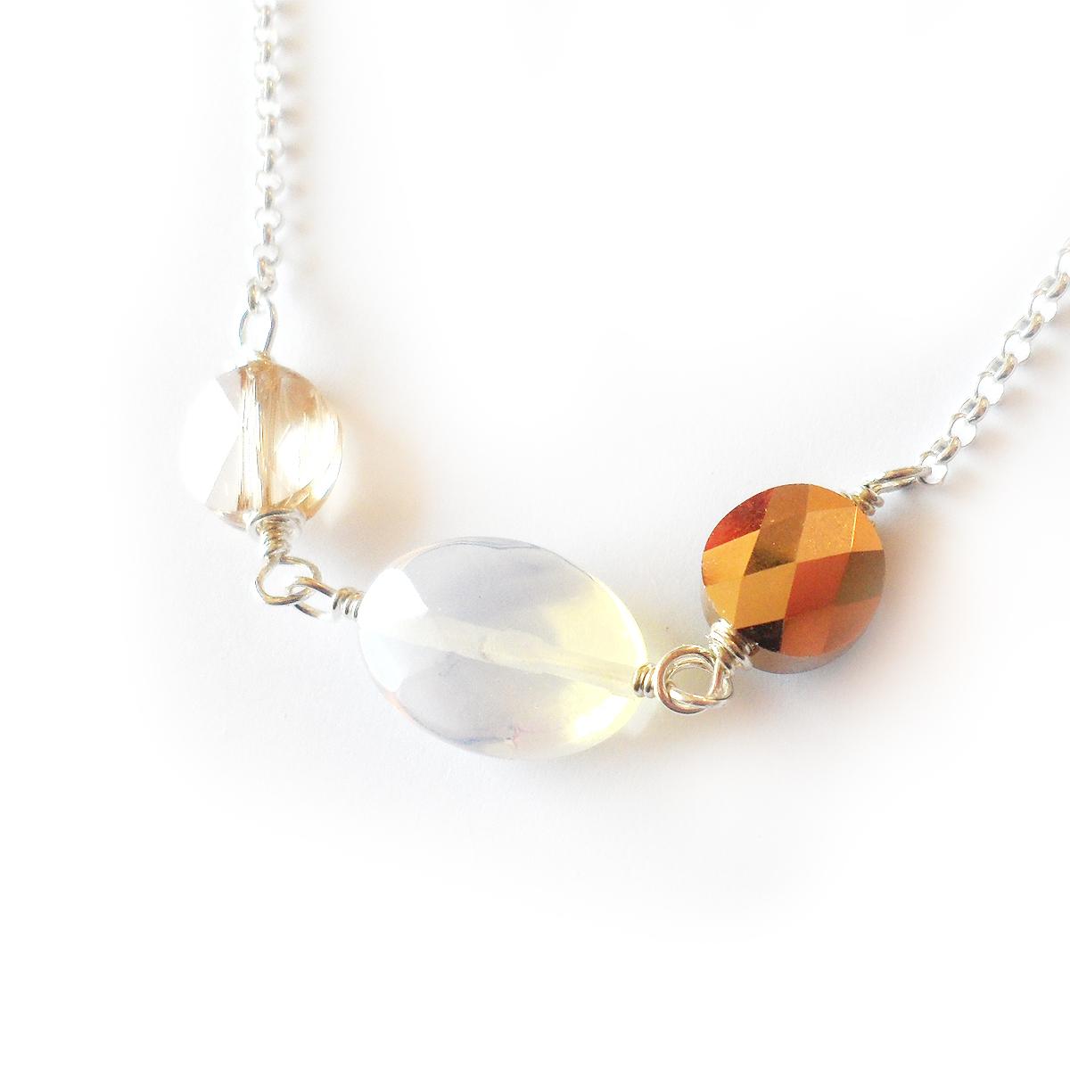 collar-charlotte-en-ovalos-de-cristal-de-swarovski-dorados-y-piedra-de-luna-4