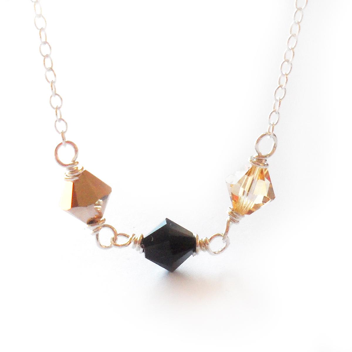 collar-melissa-plata-de-ley-y-cristales-de-swarovski-dorado-y-negro-4
